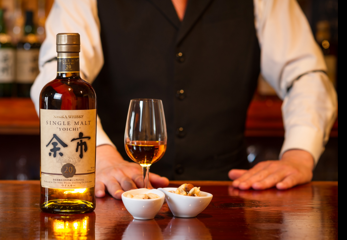 A Japanese bartender pairing Yoichi whisky with food